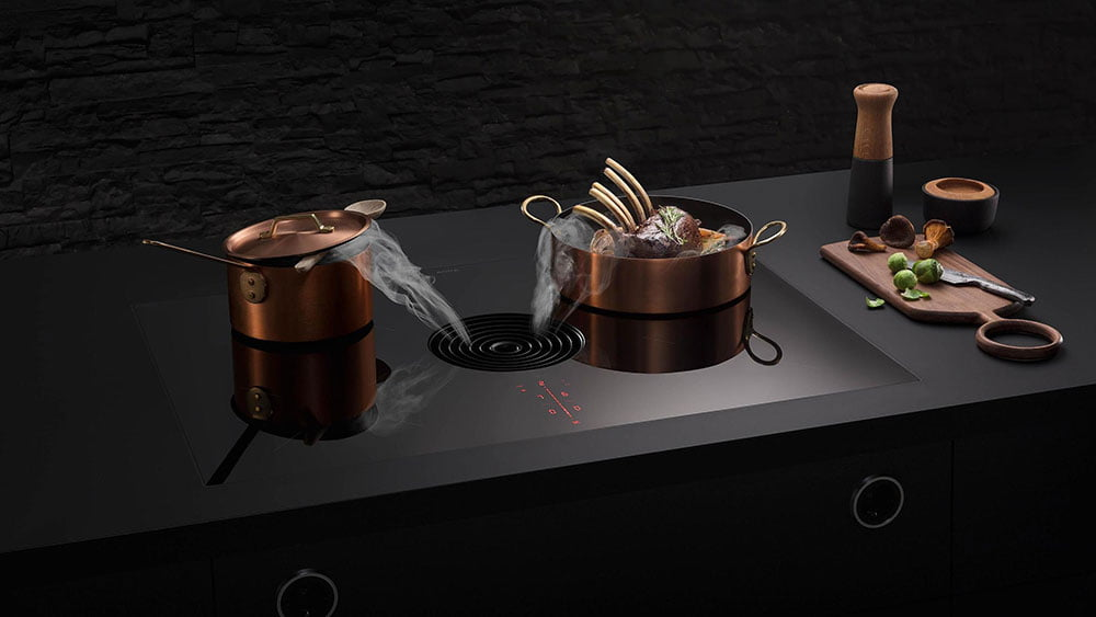 Bora Pure with copper pots and downdraft extractor